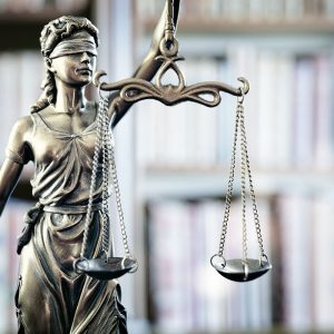How to Retain a Criminal Lawyer While in Jail in California?